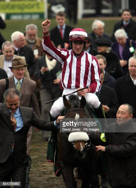 Tiger Cry and jockey Davy Russell celebrate winning the Johnny Henderson Grand Annual Steeple Chase during the Cheltenham Festival at Cheltenham...