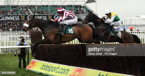 Tiger Cry ridden by Davy Russell clears the last ahead of Andreas ridden by Ruby Walsh to win the Johnny Henderson Grand Annual Steeple Chase during...
