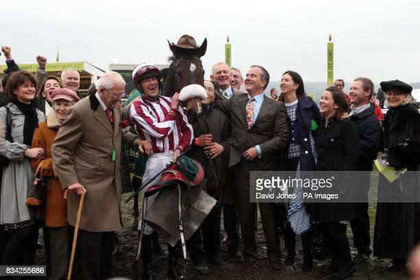 Tiger Cry with jockey Davy Russell and owner Chris Jones after they won the Johnny Henderson Grand Annual Steeple Chase during the Cheltenham...