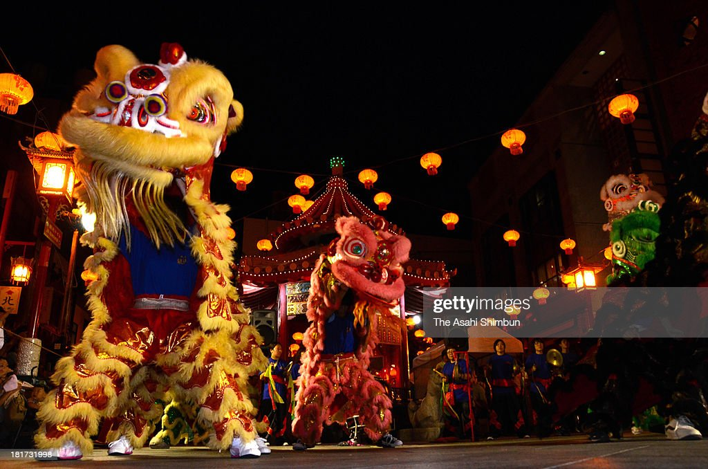 Tiger dance is performed during the midautumn harvest festival at Nankin-machi, biggest China Town in western Japan, on September 22, 2013 in Kobe, Hyogo, Japan.