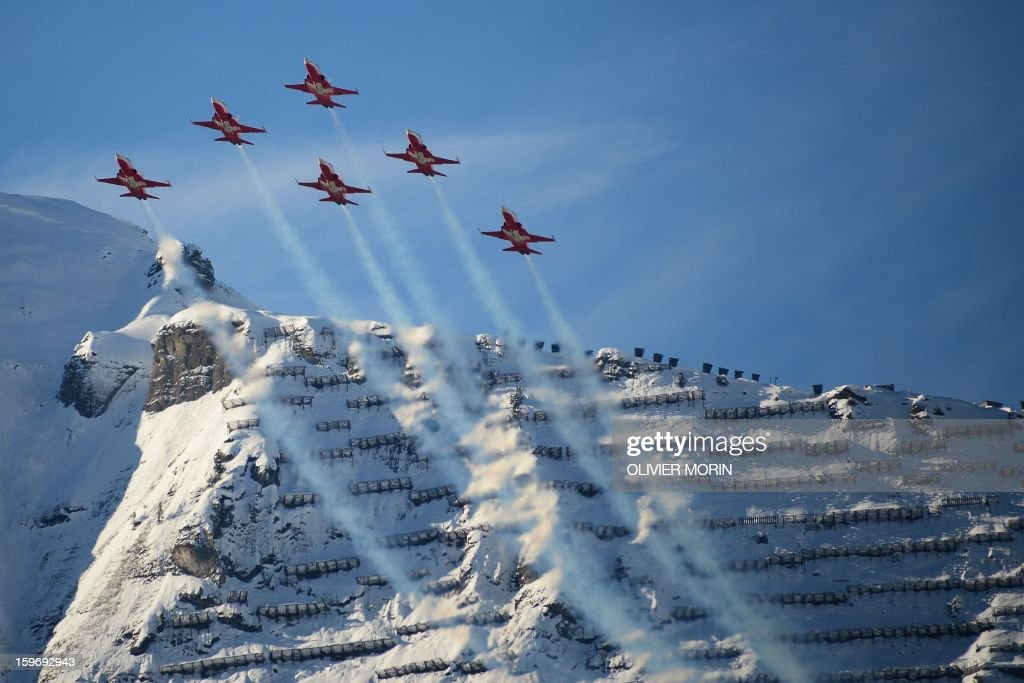 F5 Tiger fighter jets of the Swiss Air Force fly before the Men's Combined race at the FIS Alpine Skiing World Cup in Wengen on January 18, 2013.