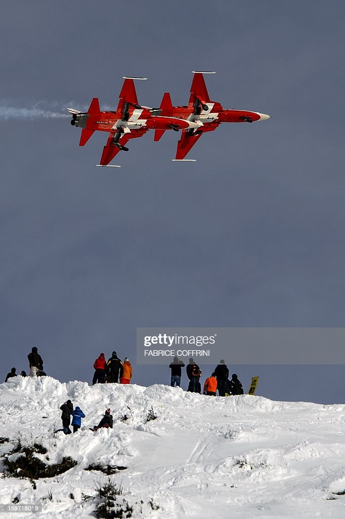 F5 Tiger fighter jets of the Swiss Air Force or 'Patrouille Suisse' perform on January 19, 2013 prior to the Men's downhill race at the FIS Alpine Skiing World Cup in Wengen.
