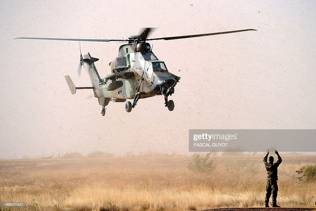 A Tiger helicopter lands at the Mopti airport, in Sevare, on February 2, 2013. President Francois Hollande visits Mali today as French-led troops work to secure the last Islamist stronghold in the north after a lightning offensive against the extremists. AFP PHOTO / PASCAL GUYOT
