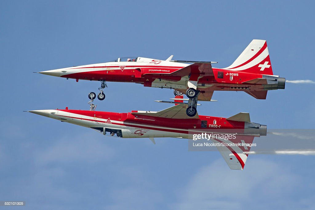F-5 Tiger II aircraft of the Patrouille Suisse aerobatic team, demonstrate the calypso pass during the AIR14 air show in Payerne, Switzerland.