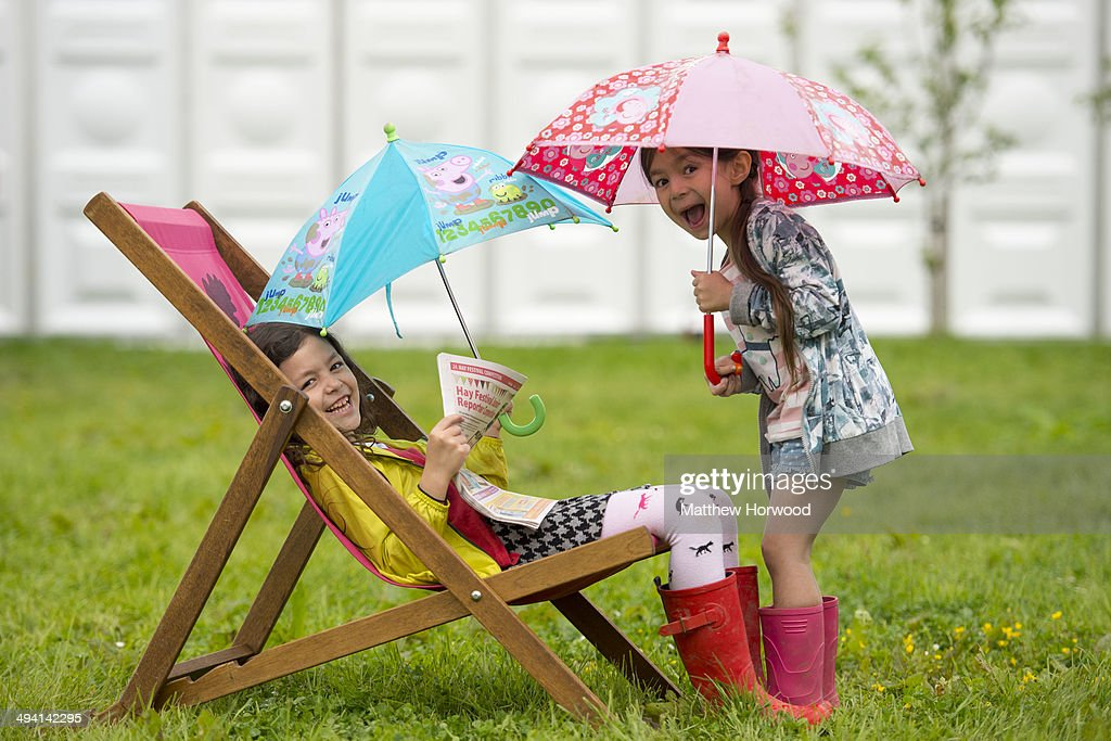 Tiger Lily Vyse, 7, with Pearl Vyse, 5, (right) during the Hay Festival on May 28, 2014 in Hay-on-Wye, Wales. The Hay Festival is an annual festival of literature and arts which began in 1988.