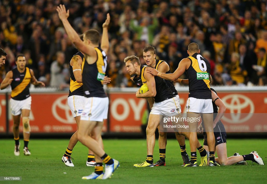 Tiger players react after Luke McGuane was awarded a free kick after a match saving tackle on Jamie Bootsma of the Blues during the round one AFL match between the Carlton Blues and the Richmond Tigers at Melbourne Cricket Ground on March 28, 2013 in Melbourne, Australia.
