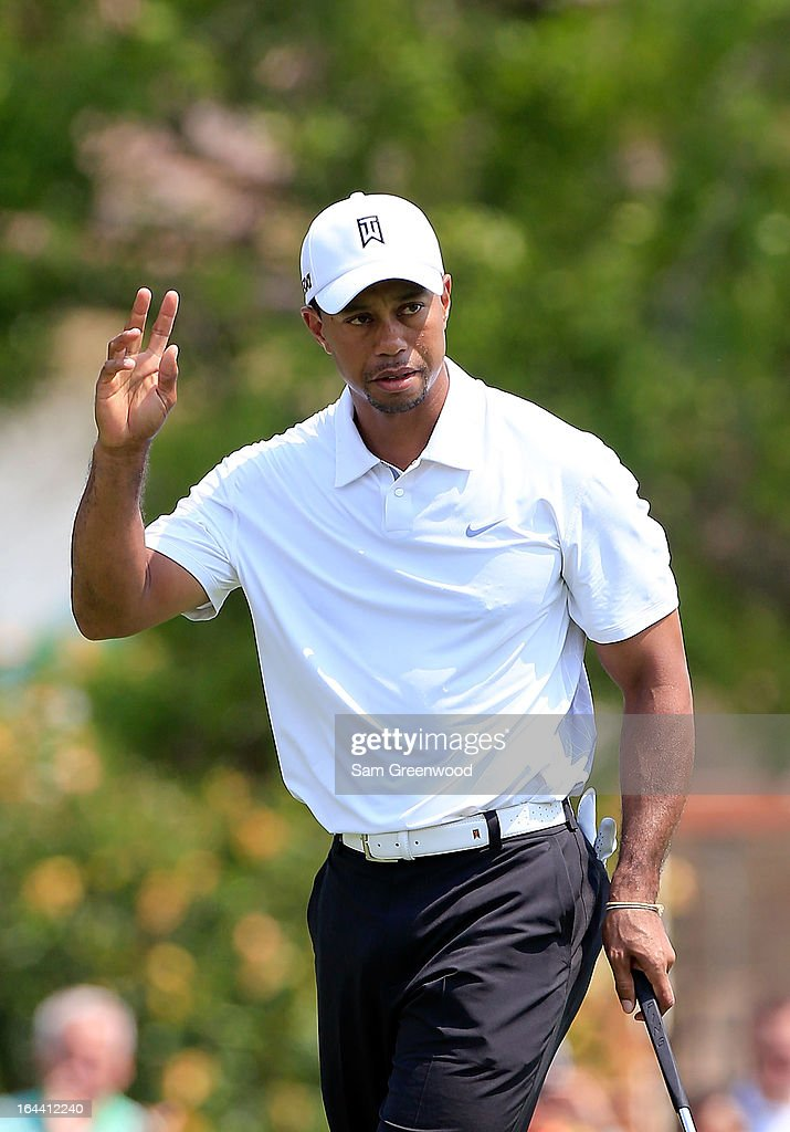 <a gi-track='captionPersonalityLinkClicked' href=/galleries/search?phrase=Tiger+Woods&family=editorial&specificpeople=157537 ng-click='$event.stopPropagation()'>Tiger Woods</a> acknowledges the crowd on the 4th hole during the third round of the Arnold Palmer Invitational presented by MasterCard at the Bay Hill Club and Lodge on March 23, 2013 in Orlando, Florida.