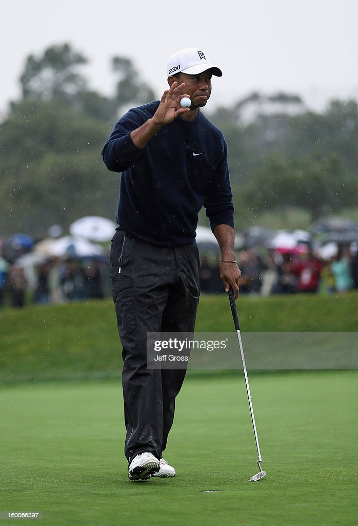 Tiger Woods acknowledges the gallery after making a birdie putt on the ninth hole during the second round of the Farmers Insurance Open at Torrey Pines North Golf Course on January 25, 2013 in La Jolla, California.
