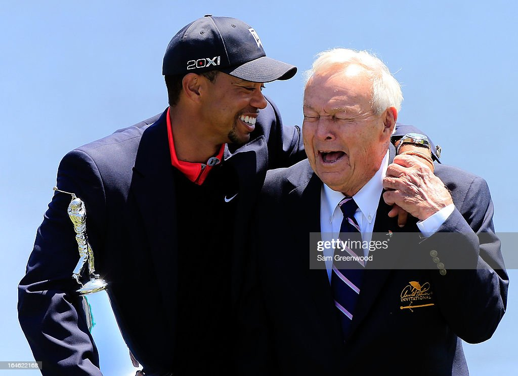 Tiger Woods (L) and Arnold Palmer laugh during the ceremony following the Arnold Palmer Invitational presented by MasterCard at the Bay Hill Club and Lodge on March 24, 2013 in Orlando, Florida.