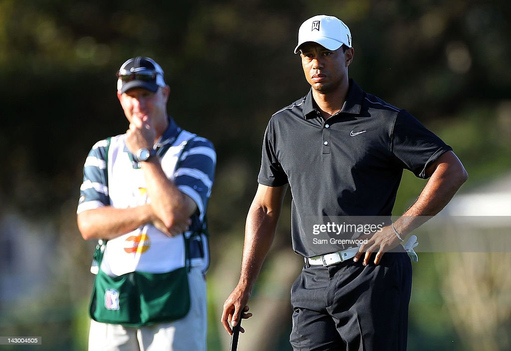 <a gi-track='captionPersonalityLinkClicked' href=/galleries/search?phrase=Tiger+Woods&family=editorial&specificpeople=157537 ng-click='$event.stopPropagation()'>Tiger Woods</a> and caddie Joe LaCava look over a shot during the first round of the Arnold Palmer Invitational presented by MasterCard at the Bay Hill Club and Lodge on March 22, 2012 in Orlando, Florida.