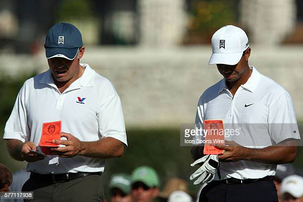 Tiger Woods and caddie Steve Williams analyze the 16th hole during the second round of the 89th PGA Championship at Southern Hills Country Club in...