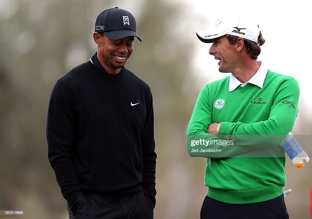 Tiger Woods and Charles Howell III talk on the 11th hole tee box during the first round of the World Golf Championships - Accenture Match Play at the Golf Club at Dove Mountain on February 21, 2013 in Marana, Arizona. Round one play was suspended on February 20 due to inclimate weather and is scheduled to be continued today.