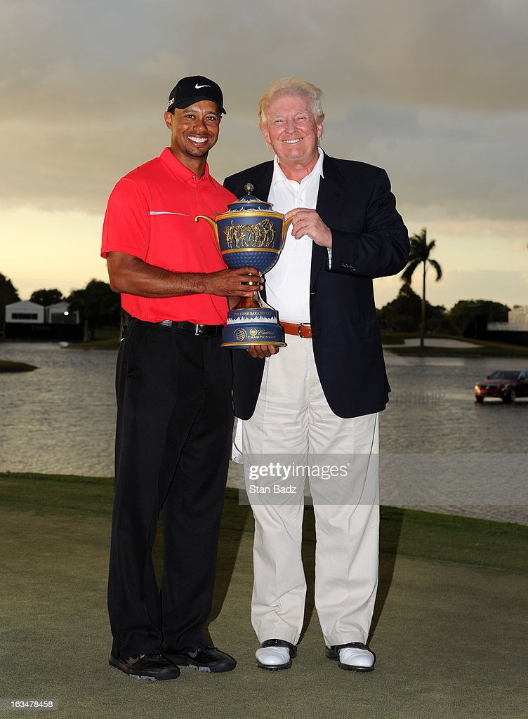 Tiger Woods and Donald Trump pose with the Gene Sarazen Cup after his two-stroke victory during the final round of the World Golf Championships-Cadillac Championship at TPC Blue Monster at Doral on March 10, 2013 in Doral, Florida.