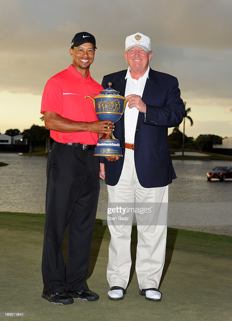 Tiger Woods and Donald Trump pose with the winner's trophy after the final round of the World Golf Championships-Cadillac Championship at TPC Blue Monster at Doral on March 10, 2013 in Doral, Florida.