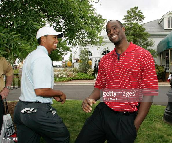 Tiger Woods and Emeka Okafor of the Charlotte Bobcats and 2005 NBA Rookie of the Year share a laugh after Woods completed his practice round at the...