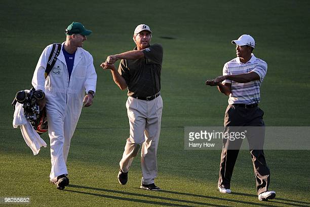 Tiger Woods and Fred Couples walk alongside caddie Joe Lacava down the first fairway during a practice round prior to the 2010 Masters Tournament at...