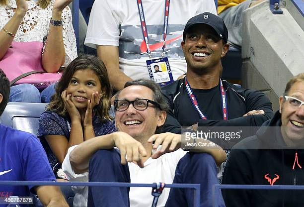 Tiger Woods and his daughter Sam Woods attend in Rafael Nadal's box his match against Fabio Fognini of Italy on day five of the 2015 US Open at USTA...