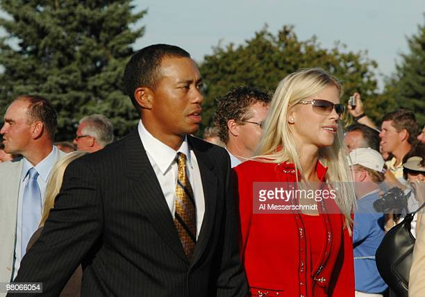 Tiger Woods and his girlfriend Elin Nordegren leave the stage after opening ceremonies at the 2004 Ryder Cup in Detroit Michigan September 16 2004