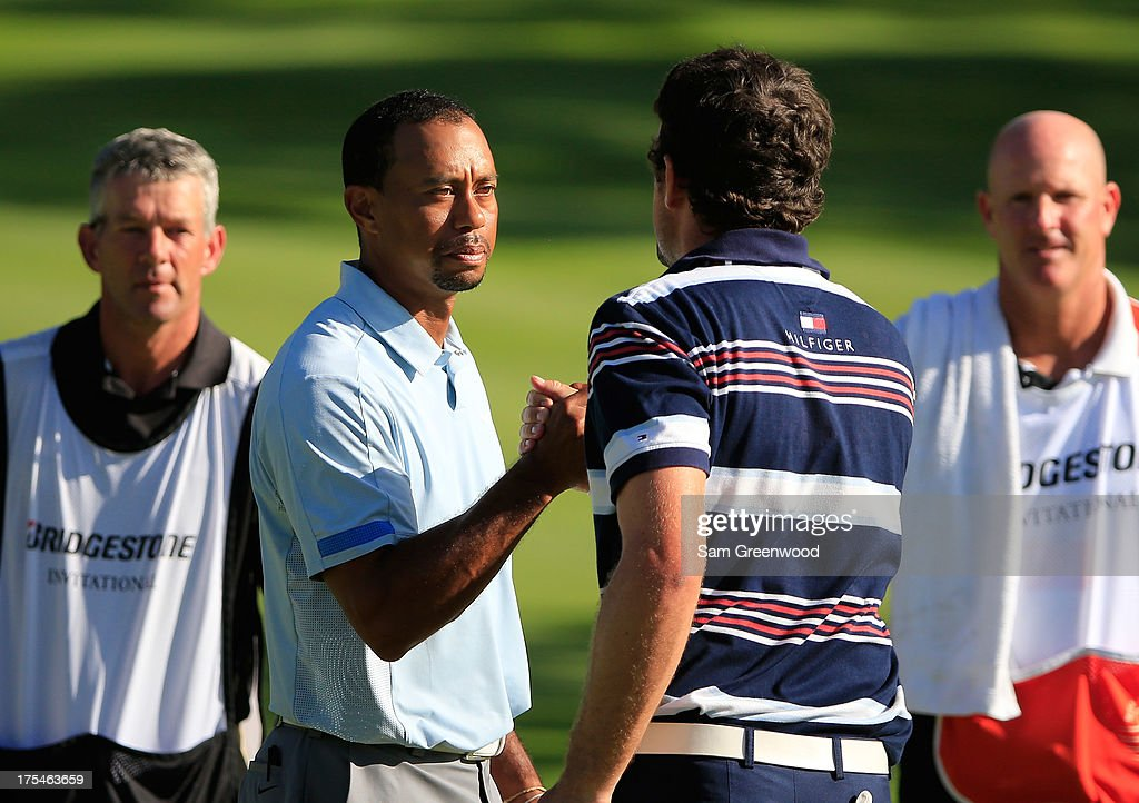 <a gi-track='captionPersonalityLinkClicked' href=/galleries/search?phrase=Tiger+Woods&family=editorial&specificpeople=157537 ng-click='$event.stopPropagation()'>Tiger Woods</a> (2nd L) and <a gi-track='captionPersonalityLinkClicked' href=/galleries/search?phrase=Keegan+Bradley&family=editorial&specificpeople=6388440 ng-click='$event.stopPropagation()'>Keegan Bradley</a> (2nd R) shake hands after finishing their round as caddies Brendan McCarthy (L) and <a gi-track='captionPersonalityLinkClicked' href=/galleries/search?phrase=Joe+LaCava&family=editorial&specificpeople=695531 ng-click='$event.stopPropagation()'>Joe LaCava</a> (R) look on during the Third Round of the World Golf Championships-Bridgestone Invitational at Firestone Country Club South Course on August 3, 2013 in Akron, Ohio.