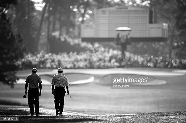 Tiger Woods and Mark O'Meara walk together during a practice round prior to the 2010 Masters Tournament at Augusta National Golf Club on April 6 2010...
