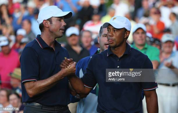 Tiger Woods and Matt Kuchar of the US Team celebrate after defeating the Cabrera/Leishman team 54 during the Day One FourBall Matches at the...
