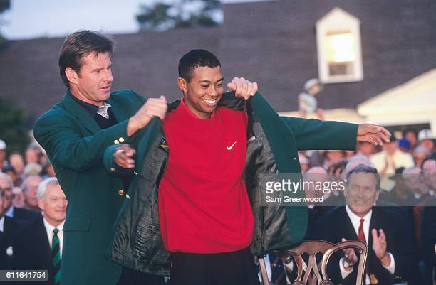 Tiger Woods and Nick Faldo of England during the final round of the 1997 Masters Tournament at the Augusta National Golf Club on April 13 1997 in...