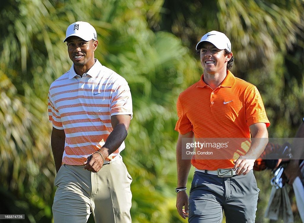 Tiger Woods and Rory McIlroy of Northern Ireland chat during the second round of the World Golf Championships-Cadillac Championship at TPC Blue Monster at Doral on March 8, 2013 in Doral, Florida.