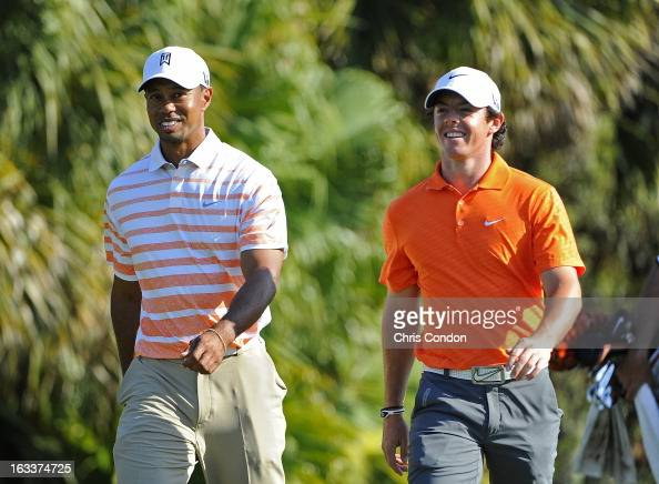 Tiger Woods and Rory McIlroy of Northern Ireland chat during the second round of the World Golf ChampionshipsCadillac Championship at TPC Blue...