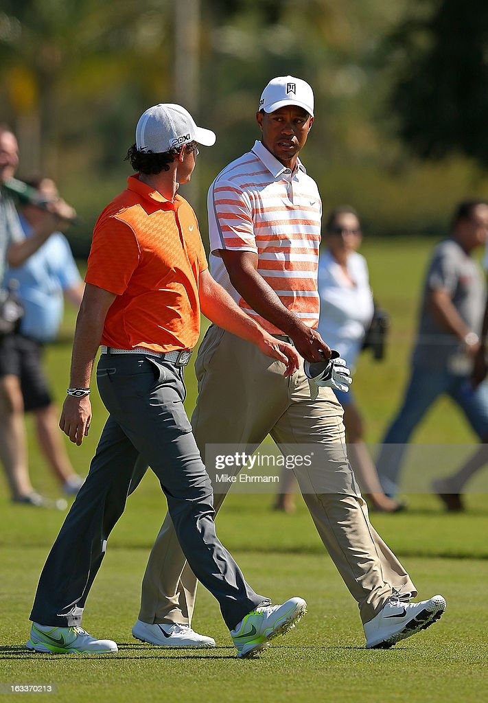 Tiger Woods and Rory McIlroy of Northern Ireland talk on the sixth hole during the second round of the WGC-Cadillac Championship at the Trump Doral Golf Resort & Spa in on March 8, 2013 in Doral, Florida.