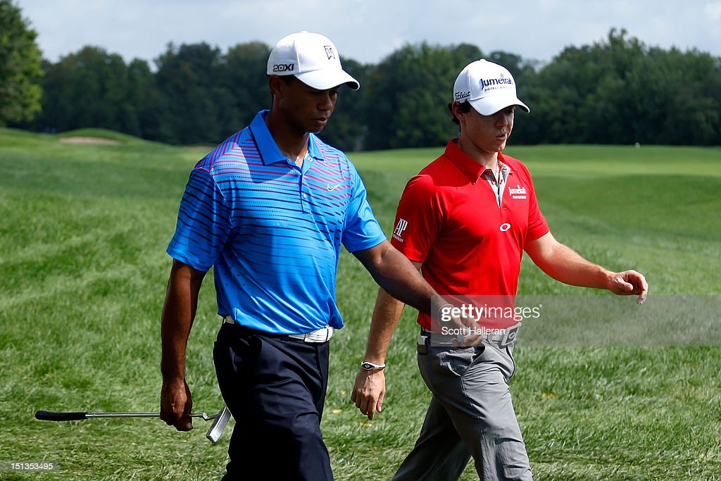 <a gi-track='captionPersonalityLinkClicked' href=/galleries/search?phrase=Tiger+Woods&family=editorial&specificpeople=157537 ng-click='$event.stopPropagation()'>Tiger Woods</a> and <a gi-track='captionPersonalityLinkClicked' href=/galleries/search?phrase=Rory+McIlroy&family=editorial&specificpeople=783109 ng-click='$event.stopPropagation()'>Rory McIlroy</a> of Northern Ireland walk along the 11th hole during the first round of the BMW Championship at Crooked Stick Golf Club on September 6, 2012 in Carmel, Indiana.