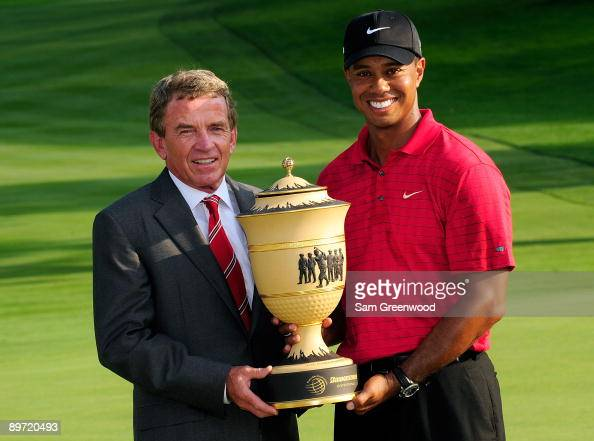 Tiger Woods and Tim Finchem Commissioner of the PGA Tour holds the Gary Player trophy following the final round of the WGCBridgestone Invitational on...