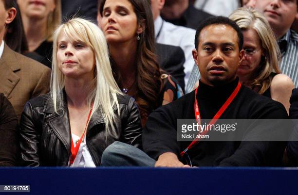 Tiger Woods and wife Elin watch as Pete Sampras and Roger Federer of Switzerland play an exhibition match on March 10 2008 at Madison Square Garden...