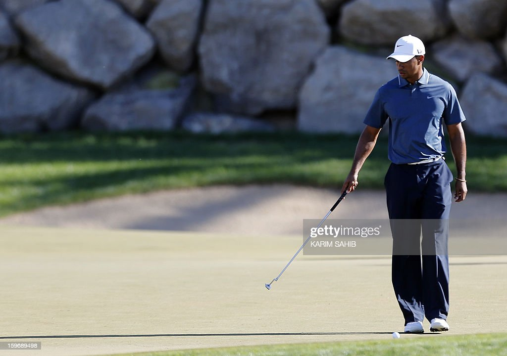 US Tiger Woods arrives to play a shot during the second round of the Abu Dhabi Golf Championship at the Abu Dhabi Golf Club in the Emirati capital on January 18, 2013.