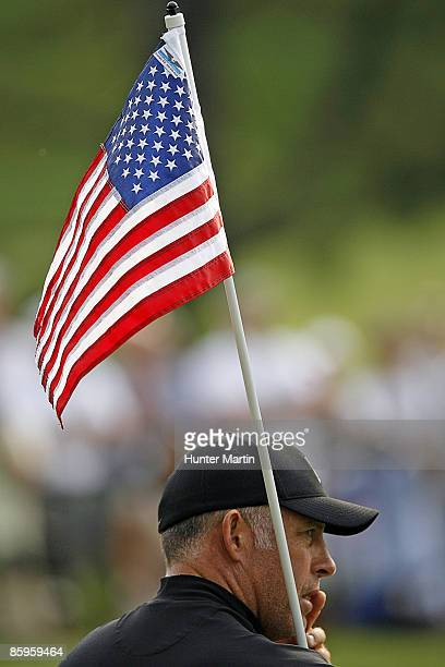 JULY 4 Tiger Woods' caddie Steve Williams tends to the American Flag flag stick during the ATT National Earl Woods Memorial ProAm at Congressional...