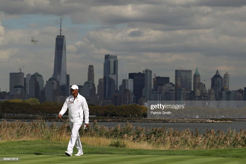 Tiger Woods, Captains Assistant of the U.S. Team, walks in front the New York City skyline during Friday four-ball matches of the Presidents Cup at Liberty National Golf Club on September 29, 2017 in Jersey City, New Jersey.