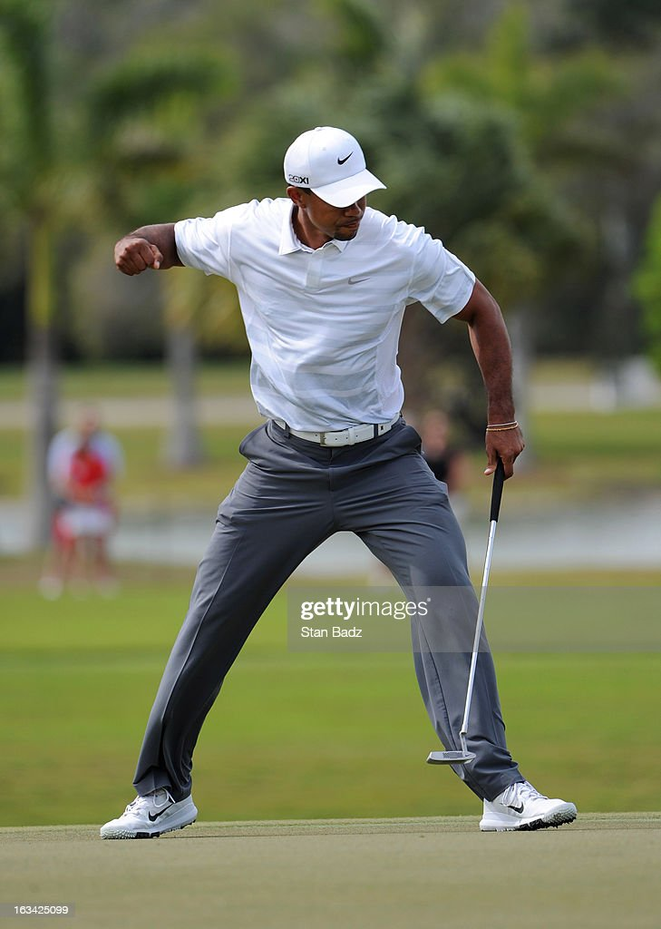 Tiger Woods celebrates after making a his putt on the fourth hole during the third round of the World Golf Championships-Cadillac Championship at TPC Blue Monster at Doral on March 9, 2013 in Doral, Florida.