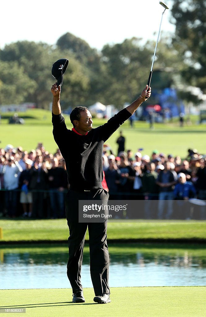 Tiger Woods celebrates after making the final putt for the victory during the final round of the Farmers Insurance Open on the South Course at Torrey Pines Golf Course on January 28, 2013 in La Jolla, California.