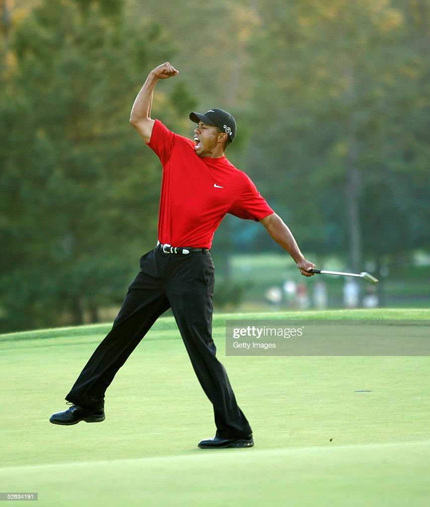 <a gi-track='captionPersonalityLinkClicked' href=/galleries/search?phrase=Tiger+Woods&family=editorial&specificpeople=157537 ng-click='$event.stopPropagation()'>Tiger Woods</a> celebrates after sinking a putt on the first playoff hole to win the 2005 Masters on April 10, 2005 at Augusta National Golf Course in Augusta, Georgia.