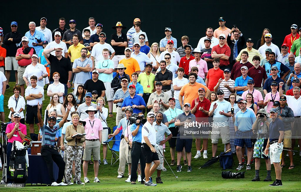 <a gi-track='captionPersonalityLinkClicked' href=/galleries/search?phrase=Tiger+Woods&family=editorial&specificpeople=157537 ng-click='$event.stopPropagation()'>Tiger Woods</a> (L) celebrates as his caddie <a gi-track='captionPersonalityLinkClicked' href=/galleries/search?phrase=Joe+LaCava&family=editorial&specificpeople=695531 ng-click='$event.stopPropagation()'>Joe LaCava</a> (R) plays a shot onto the 17th green during a practice round for THE PLAYERS Championship at the TPC Sawgrass Stadium course on May 6, 2015 in Ponte Vedra Beach, Florida.