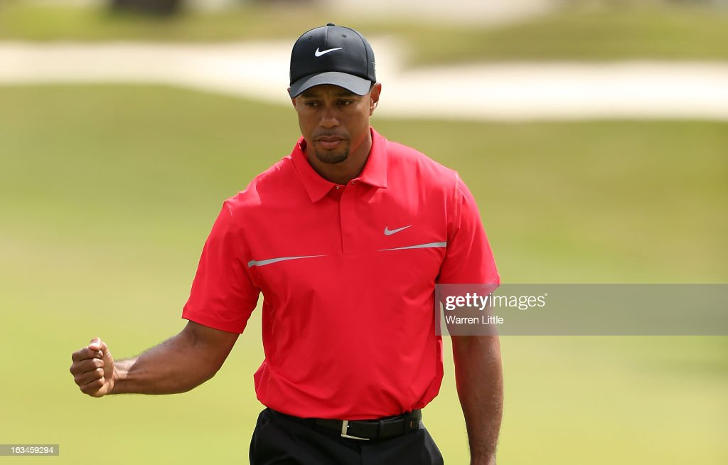 Tiger Woods celebrates his birdie putt on the second hole during the final round of the World Golf ChampionshipsCadillac Championship at the Trump...