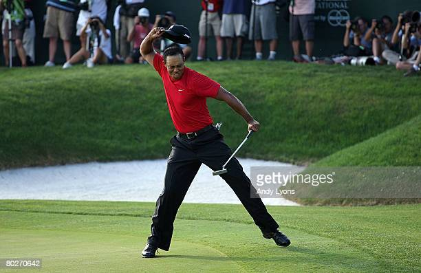 Tiger Woods celebrates making a birdie on the 18th green to win the Arnold Palmer Invitational on March 16 2008 at the Bay Hill Club and Lodge in...