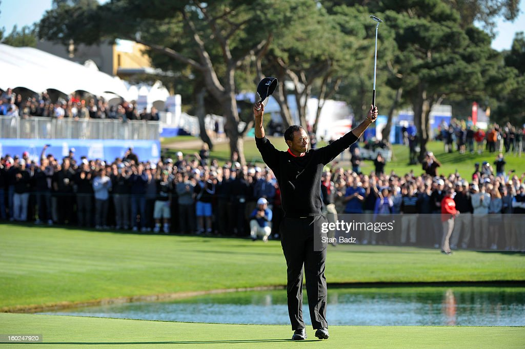 Tiger Woods celebrates on the 18th green after winning the Farmers Insurance Open at Torrey Pines Golf Course on January 28, 2013 in La Jolla, California.