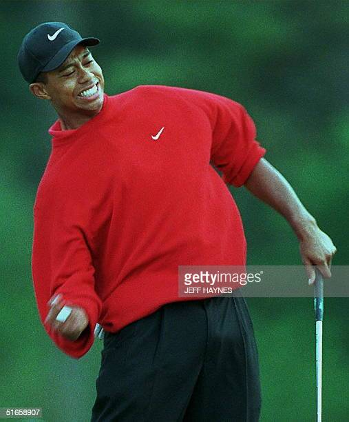 Tiger Woods celebrates on the 18th hole 13 April after winning the Masters tournament at Augusta National Golf Club in Georgia Woods set a new...