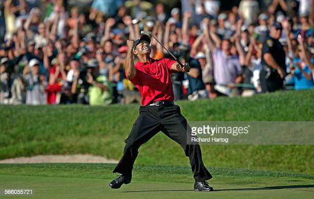 Tiger Woods celebrates on the eighteenth green after sinking a putt for a birdie and to force a playoff with Rocco Mediate during the final round of...