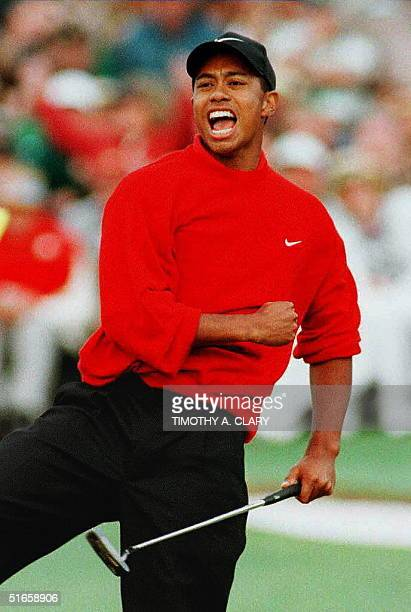 Tiger Woods celebrates on the eighteenth green after winning the 1997 Masters tournament at Augusta National Golf Club in Georgia Woods finished with...