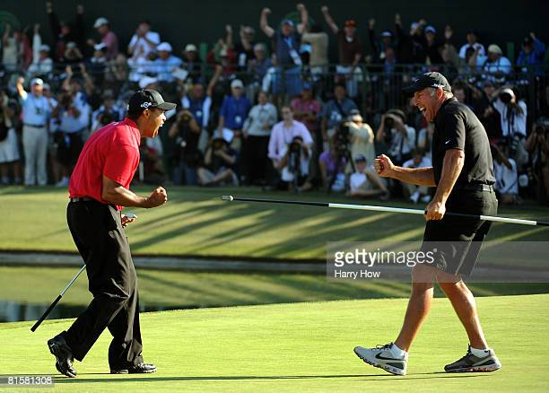 Tiger Woods celebrates with caddie Steve Williams after sinking his birdie putt on the 18th green to force a playoff with Rocco Mediate during the...
