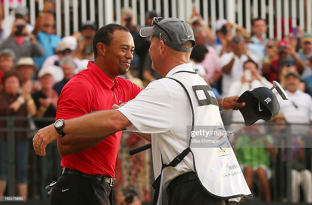 Tiger Woods celebrates with his caddie Joe LaCava after his two-stroke victory at the World Golf Championships-Cadillac Championship at the Trump Doral Golf Resort & Spa on March 10, 2013 in Doral, Florida.