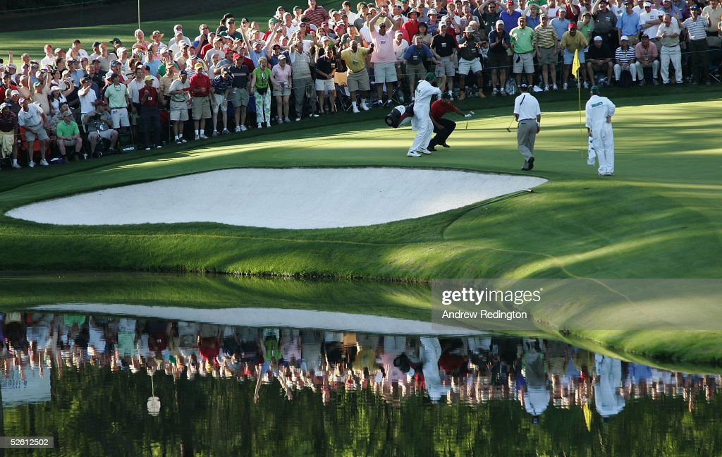 <a gi-track='captionPersonalityLinkClicked' href=/galleries/search?phrase=Tiger+Woods&family=editorial&specificpeople=157537 ng-click='$event.stopPropagation()'>Tiger Woods</a> celebrates with his caddie Steve Williams after chipping in for birdie on the 16th hole during the final round of The Masters at the Augusta National Golf Club on April 10, 2005 in Augusta, Georgia.