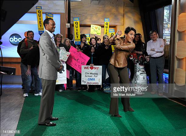 AMERICA Tiger Woods challenges Robin Roberts to play his new golf video game on GOOD MORNING AMERICA 3/15/12 airing on the ABC Television Network...