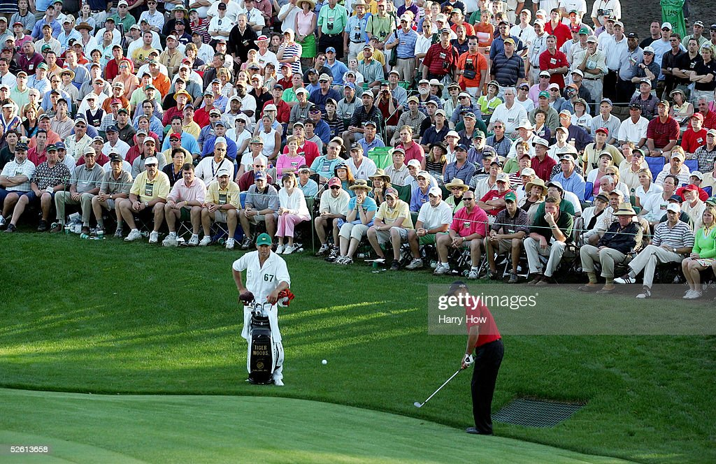 <a gi-track='captionPersonalityLinkClicked' href=/galleries/search?phrase=Tiger+Woods&family=editorial&specificpeople=157537 ng-click='$event.stopPropagation()'>Tiger Woods</a> chips a shot to the 16th green for birdie as his caddie, Steve Williams, looks on during the final round of The Masters at the Augusta National Golf Club on April 10, 2005 in Augusta, Georgia.